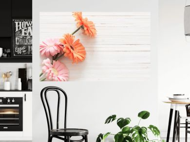 gerbera flowers on the wooden table