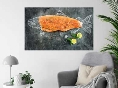 raw salmon fish steak with ingredients like lemon, pepper, sea salt and dill on black board, sketched image with chalk of salmon fish with steak
