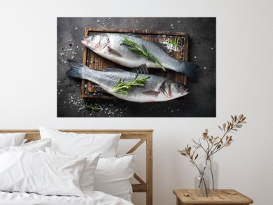 Fresh fish seabass on black background.