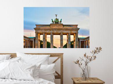 Brandenburg gate illuminated at sunset , Berlin, Germany