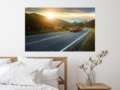 light truck passing highway of aspiring national park most popular traveling destination in west coast southland of new zealand