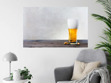 Glass of light beer on the wooden table