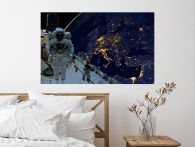 astronaut spacewalk at night from the dark side of the earth planet. Elements of this image furnished by NASA d