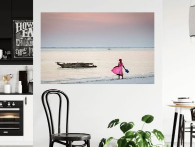 Young girl in pink playing on the beach of Zanzibar Island, Tanzania