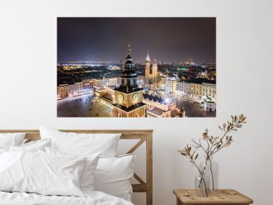 Aerial drone view Cracow old town and city main square at night.