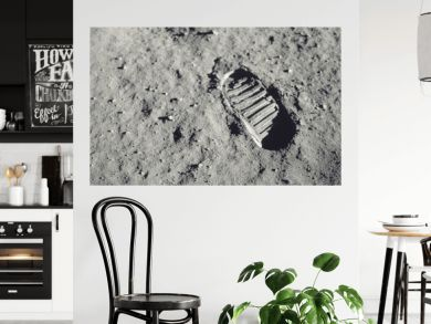 Step on the moon. Elements of this image furnished by NASA