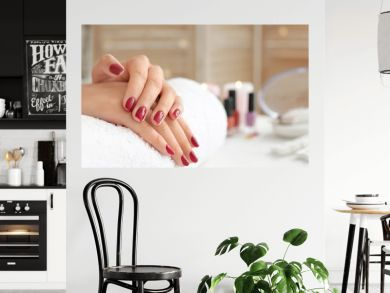 Woman with beautiful manicure in salon
