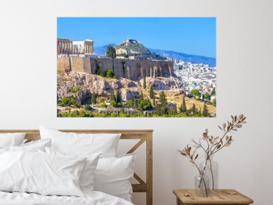 Panoramic view of Athens, Greece. Famous Acropolis hill rises above cityscape. It is top landmark of Athens. Landscape of old Athens city with Ancient Greek ruins. Skyline of Athens in summer.