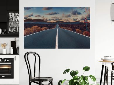 Image related to unexplored road journeys and adventures.Road through the scenic landscape to the destination in Lanzarote natural park