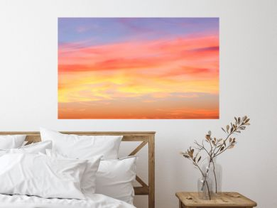 Beautiful red and orange cloud formations at sunrise in  a panorama sky view