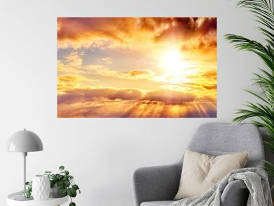 dramatic sunset sky landscape background natural color of evening cloudscape panorama with setting sun rays highlighting clouds ultra wide panoramic view