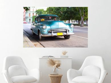 Metallic green oldtimer car in the streets of Havana