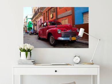 Vintage red car on the street of old city, Havana, Cuba