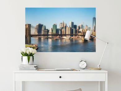 Brooklyn bridge and Manhattan at sunny day, New York City