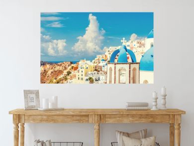 Three Domes church panoramic view of Santorini island, Oia village, Greece. Famous Europe travel european destination greek island. Horizon landscape banner crop for advertisement copyspace.