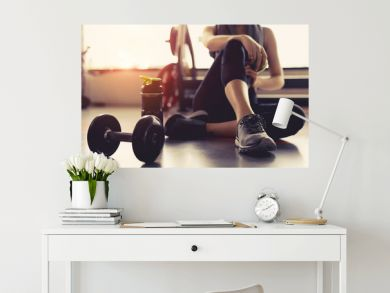 Woman exercise workout in gym fitness breaking relax holding apple fruit after training sport with dumbbell and protein shake bottle healthy lifestyle bodybuilding, Athlete builder muscles lifestyle.
