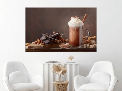 Hot chocolate with cream, cinnamon, chocolate pieces and various spices.