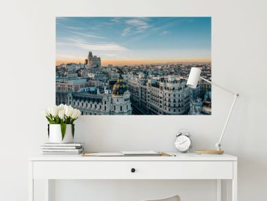 View of the Metropolis Building and Gran Via from the Circulo de Bellas Artes rooftop at sunset, in Madrid, Spain