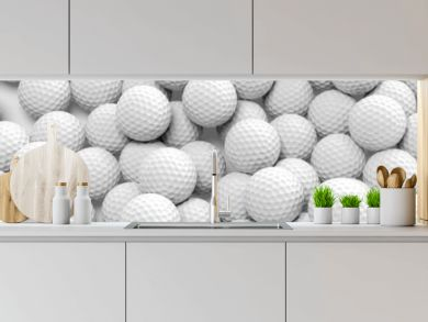 Many golf balls together closeup isolated on white