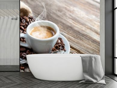 Espresso Coffee Cup With Beans On Vintage Table