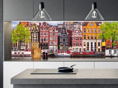 Amsterdam Netherlands dancing houses over river Amstel landmark