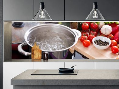 boiling water in a cooking pot on the cooker