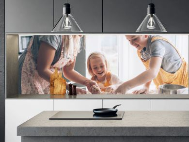 Mom cooking with kids on the kitchen