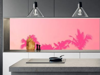 Palm tree silhouette pink pastel sky with copy space summer concept