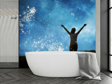Girl watching the stars in night sky fantasy landscape