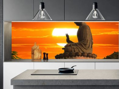Buddha statue at sunset