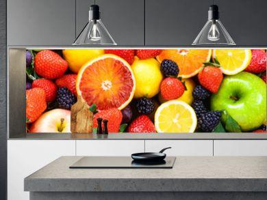 Fresh fruits mixed.Tasty fruits background.