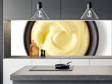 Mayonnaise in round dish on white background