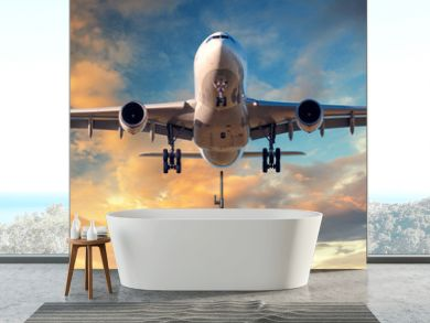 Landing airplane. Landscape with white passenger airplane is flying in the blue sky with clouds at colorful sunset. Travel background. Passenger airliner. Business trip. Commercial aircraft. Concept