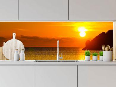 Sunrise or sunset over sea surface