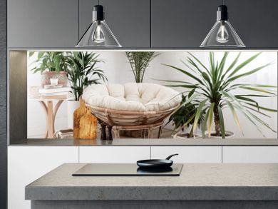 House with cozy boho ethnic interior with plants.