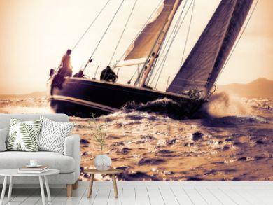 sail boat sailing on sunset