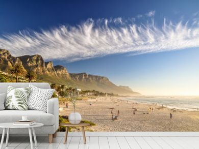 Stunning evening photo of Camps Bay, an affluent suburb of Cape Town, Western Cape, South Africa. With its white beach, Camps Bay attracts a large number of foreign visitors as well as South Africans.