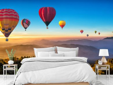 Colorful hot air balloons flying over mountain at Dot Inthanon in Chiang Mai, Thailand..