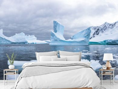 Panoramic view of kayaking in the Iceberg Graveyard in Antarctica