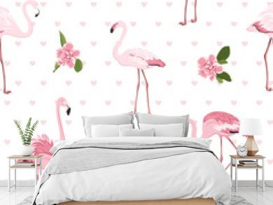 Pink exotic flamingo birds, bright tropical camelia flowers, green leaves and hearts on white background. Stylish seamless pattern for fashion, fabric, textile, decoration. Vector design illustration.