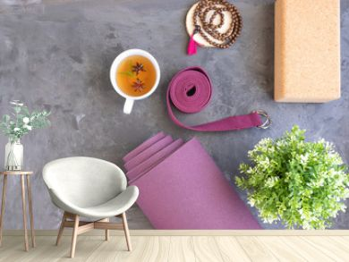 Rolled yoga mat with mala beads and Ayurveda tea for relax yoga practice y meditation.