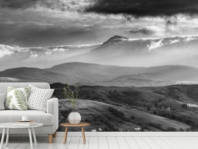 Amazing Carpathian  panoramic landscape of  misty mountain hills and cloudy sky in black and white. Ukraine.