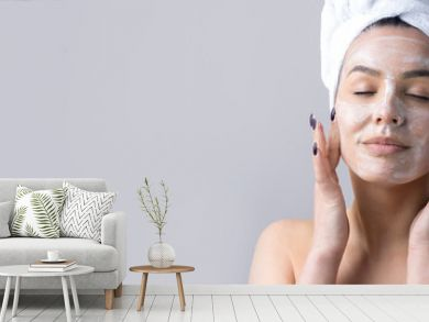 Beauty portrait of woman in white towel on head  with a sponge for a body in view of a pink heart. Skincare cleansing eco organic cosmetic spa relax concept.