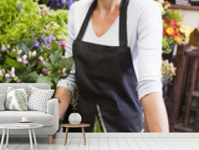 Woman working at flower shop smiling