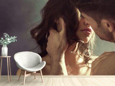 Sensual woman kissing her husband