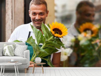 Portrait of florist next to his shop