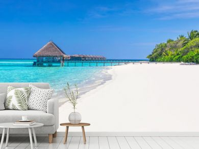 Panorama of wide sandy beach on a tropical island in Maldives