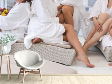Group of woman in robes Womens legs in the spa