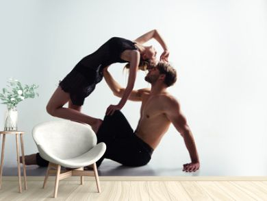 Expressing their love in dance. Dance school training. Couple of dancers. Young woman and man dance love and romance. Muscular man and cute woman perform modern dance. Romantic relationship