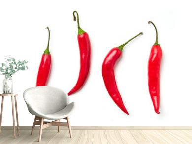Red chili pepper on a white background. Red chili pepper of different shapes isolated on white background